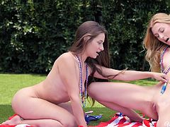 It's election time in America, so two pretty girls were promoting their favorite politician in the park. It was hot outside, so they removed their bras and rubbed sunscreen. It was enough to fill them with lust and they started to kiss each other. They were sucking boobs, licking pussies and fucking...