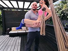 Kira is hanging out with Jmac, relaxing in the hammock. He picks her up, she grabs the beams overhead, and he gives her a bit of a licking, after moving her panties. They go inside, where she can get comfy and stretch her mouth, before he stretches her pussy.