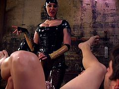 Maitresse Madeline Marlowe is a divine one indeed. She has an appointment to dominate and punish Rick, but she wants sex as well. She brings Tommy with her, allowing him to give it to her from behind, as she torments her slave's asshole with dildos and other items.