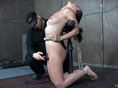 Roxanne is bound and gagged by her executor. As you can see, the position she's in isn't very comfortable, but what he does to her pussy with that powerful vibrator, makes the pain worth it, as she gets closer to orgasm.