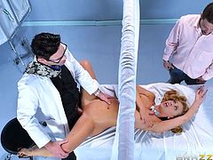 Dr. Dera is examining Cherie's vagina. His fingers, tongue and cock get used instead of the regular tools, but that's not what makes this so exciting. Her husband is there at her head, while the doctor is eating her pussy on the other side of the privacy curtain.