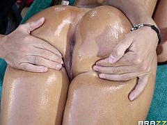 She sprays herself with the hose and the water just trickles off her huge tits and down her sexy body. Her man rubs oil all over the hot mom's tits, and then they head inside for some hot and sexy intercourse.