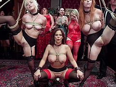 This lusty show is really worth seeing! Two pretty babes tied in ropes and suspended in the middle of the crowded hall. They get hard dicks up their wet holes and some electric shocks, for better stimulation. They cry and moan in pleasure, asking for deeper penetration. Enjoy this wild orgy on the upper floor!