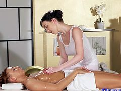 Daphne is in charge of ensuring that Morgan, the client, gets her full relaxation. She does this with her wonderful oils and talented hands at first, but then she starts getting as naked, as the woman she's rubbing, tenderly kissing and touching her.