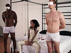 They are completely blindfolded so they can enjoy the sensual site of sexy tattooed babe Joanna. The alt mistress is teasing their cocks and sitting on their faces. The pleasure they experience is through touch only.