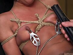 Threesome in bdsm, the most brutal combination of sex I ever had. I was tied on bed, sucking a big cock, while the other guy was fucking my pussy from behind. They tied my boobs with ropes, pinched nipples with clamps, and put ball gag in my mouth. He was fucking my ass hole, stimulating my cunt with vibrator.