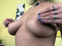 You can't take off your eyes from this mature blonde's voluptuous body and huge boobs. She had taken care of her body really well and her boobs aren't saggy. In this solo masturbation session also, she kissed her tits and played with them, before starting fingering session.