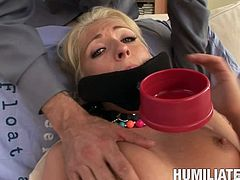 Raunchy blonde slag gets mummified and banged hard