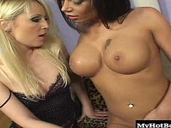 Candy Strong and Jasmin Field are two super hot chics, who youll get to watch as they sit on the couch, taking off their lingerie in order to do some lesbian big boob massaging, nipple sucking and tongue licking. The big titted brunette gets to lick her blonde lovers mostly shaved snatch, until the blonde finger fucks her pussy and uses a toy for her an orgasm.