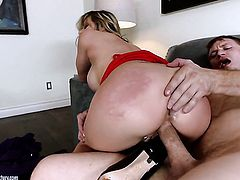 Blonde with gigantic melons takes cum shot on her nice face