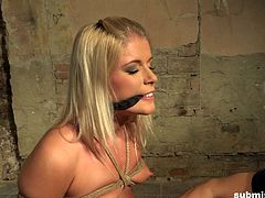 Sandy is a sex slave that must obey. Her master make all decisions for her and says when she can cum. The vibrator engorges her clit, but will the master let his bound slave have an orgasm? Watch and find out.