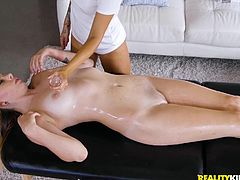 She needed some practice with her massage training, so she asked her roommate to relax and let her spread oil all over her body. Things turned sensual very quickly. She rubbed her thighs and moved up to her puffy pussy lips.