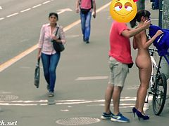 Jeny Smith loses her dress on the streets. She needs some help to put it back because she is totally naked in public