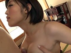 This pretty young Japanese chick is a bit shy, but she's feeling so horny, she can't wait to get down and dirty with him. She gets him aroused by squeezing his hard prick between her luscious boobs. After giving him a loving blowjob, she gets her bushy cunt fucked deep and hard.