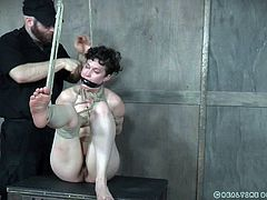 Bonnie is tied with rope and hanging in the air. Sounds good, yeah! At first she was really horrified, but these guys in black, fingered her tight asshole and made her cum with the help of vibrator. Join and enjoy!
