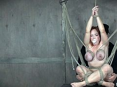 This naughty babe is tied up so tightly. She has rope wrapped around her boobs and it is very painful for her. How much torture can she possibly handle? The master presses a vibrator against her wet vagina. She cums hard.