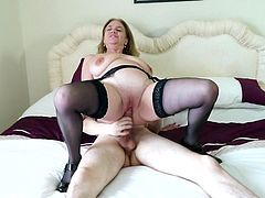 Lusty lady Lily has some free time on her hands, but instead of taking a nap, as a lot of women her age do, she decides to spend it having sex. Watch her, clad in black stockings, as she slurps on a skinny guy's erection, and straddles him energetically reverse cowgirl style.