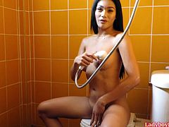 Amateur Thai tranny Candy enters a bathroom, shortly takes shower and starts stroke her dick. Candy cums into hand, but cum drops scuds on the cameraman.