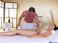 Max goes beyond his job to give a relaxing massage. He makes sure all clients experience a happy ending, and brunette beauty Tiffany is no exception. His skilled hands gliding over her slick boobs, his fingers in her wet cunt, arouses her so much, she can't stop herself from sucking his cock.