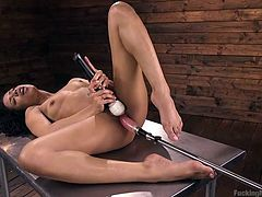 Kira is a hot chick who can have pretty much any man she likes. But she chooses to spend time alone with two big dildos. She lies spreadeagled on a table, touches herself and penetrates her pussy with a dildo. This ebony hotty can definitely handle more than one!