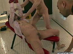 Miu is tied up on her knees and is taking a rough fucking while the other dude pisses on her face, collecting the piss in a bowl just to pour it on her face again.