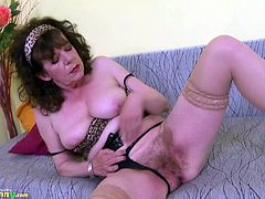 Hot mature lady is playing alone masturbating with her sex toy Find this video on our network Oldnanny.com