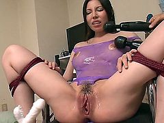 This milf brunette with luscious lips is having her pussy examined by dr. dildo in this Japanese bondage video. Her hairy pussy is dripping wet and craves for more, and more and more