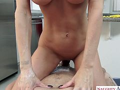 Fake tittied housewife Jessica Jaymes is riding a hard cock on a pov camera
