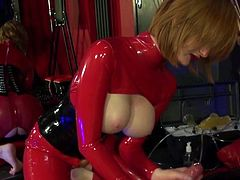 Red Head In Latex Cat Suit Fucks Guy In Latex Body Suit