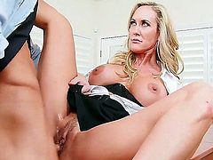 Brandi is a sexy blonde cougar bitch with massive boobs. Her young and handsome employee Ryan is slacking off, so she decides to give him a lesson and fucks him hard.