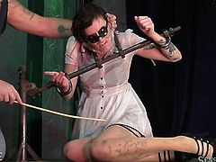 We can hardly recognize the face of this submissive slave. Special glasses cover her eyes and a plastic bag covers her head. In addition to all this, Penelope Davenport is also tied to a special bondage device and constantly gets punches from her torturer. Maybe this all is too much for her?