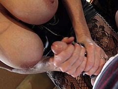 Kelly Madison enjoys giving a handjob to a horny lover