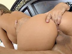 Blue eyed hottie Britney Amber swallows a meaty cock and gets her slit fucked