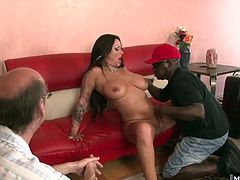 And watch her take a long hard black cock inside of her She spreads her pussy for him and slips his dick right inside her fuck hole and they do it in half a dozen positions on the couch. Her big tits and face get most of the cumshot in the end.