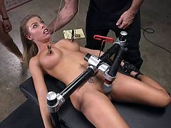 This is the third day of her week long slave training in the basement of the Armory and today, Britney will experience unusual sensations. She will be placed in a special bondage device and while her nipples will be pinched, and her clit will be stimulated with the help of vibrator, she will be brutally mouth fucked by her master