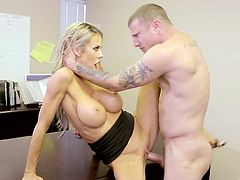 Fake tittied secretary Courtney Taylor seduces her boss and gets fucked right on the table