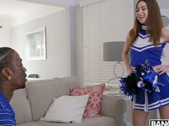 Sweet and sexy cheerleader, Riley Reid, wraps her cute lips around a huge black cock. Watch her gag on the massive ebony penis. The cutie slobbers all over him and fondles his beautiful balls. What a sexy scene this is!