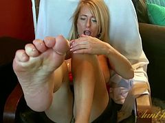 Hot blonde Milf plays with her feet