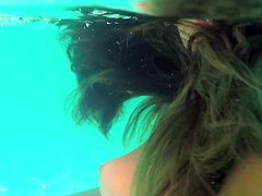 Holly gets naked in the pool