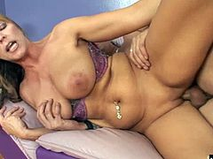 Nicole Moore is a mature blonde MILF, who loves pinching the nipples on