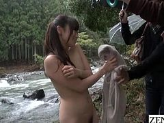 Legendary JAV star Yuu Kawakami takes off her coat and walks around stark naked in nature on a rainy day as a group of clothed men follow eager to have their dicks played with subtitled in English