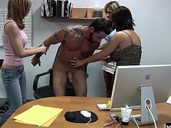 When a construction worker drops by asking if the power is on but when he sits down in one of the desk chairs, the ladies gang up on him and the CFNM begins, as they pull off his shirt and pants leaving him sitting there with an erection while they give him a handjob for a cumshot.