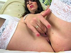 She likes to be watched as she slides her fingers deep into her vagina. This mature lady makes herself orgasm by playing with her clittoris and labia. Her pussy looks so fuckable, but since you are not there with her, she will have to cum all on her own.