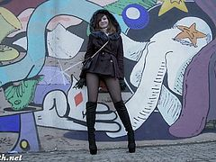 Jeny Smith teases us with her short coat and pantyhose. She is bottomless and stylish