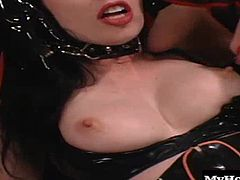 In this first BDSM scene, youll find a mistress Anastasia Pierce and her submissive playmate Darenzia wearing their rubber outfits, along with a pair of fishnet stocking as the chained brunette lets the sexy Anastasia gag her, before sucking on her huge hooters. Next, she uses clamps on her nipples until she bends her over to see her bubble butt.
