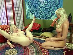 This hot lesbian couple knows how to get as much pleasure as possible. Leya Falcon places her horny lover, London River, on all fours and started to penetrate her ass with a huge elastic dildo... Hot stuff!