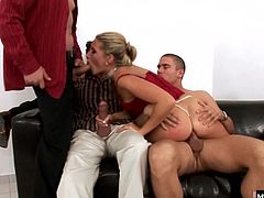 Cherry shares some very personal attention to each of their cocks before suggesting that they take all her holes in a mouth filling, hot double penetration Teamwork never looked so sexy