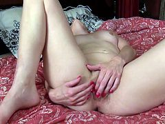 She's alone and very horny, so since she is missing you, she decides to get herself off and cum. This vibrator makes her move with such pleasure, and soon she will cum and make the sheets all dirty with her pussy juice.