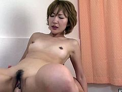 She is a slutty Asian babe who loves getting fucked by her man. This time, she has a pair of dudes who are annihilating her wet pussy and she almost gets a sloppy creampie.
