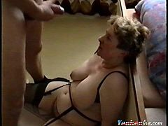 A good shot of a bbw milf wearing black lingerie sitting on the floor eagerly waiting for her man to spray her with his hot and sticky cum.